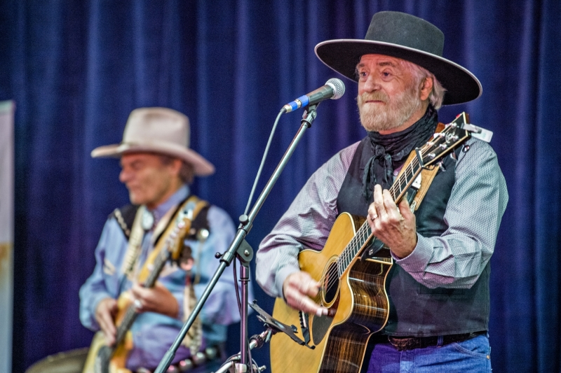 Michael Martin Murphey performing onstage with Gary Roller